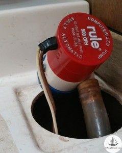 Old bilge pump, still attached to hose.